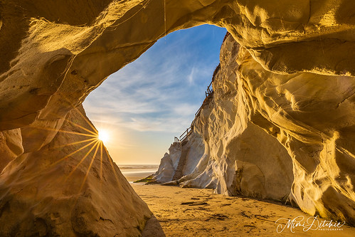 pismo pismobeach cave lowtide seascape sunset staircase abandoned sun sunstar clouds seacave getty gettyimages mimiditchie mimiditchiephotography