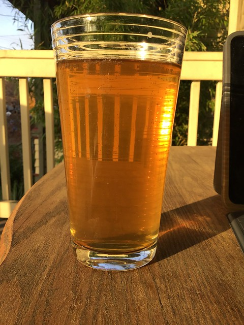 Honey Helles ale from Matchless on table outside.