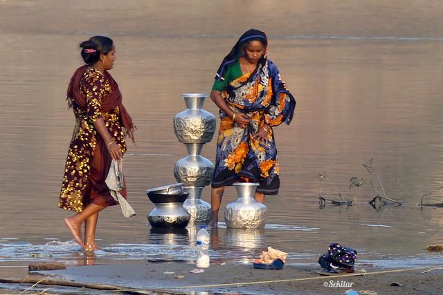 Cleaning pots, Bandarban Town, Sangu river banks