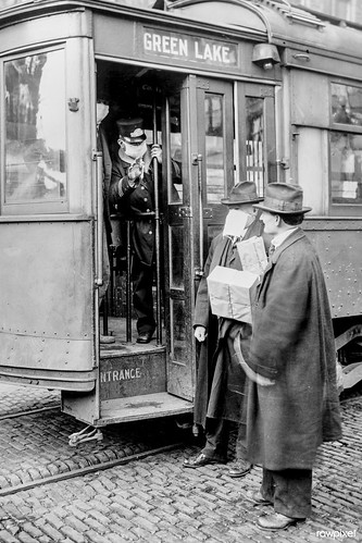 Precaution during the Spanish Influenza Epidemic would not permit anyone to ride on the street cars without wearing a mask, Seattle, Washington (ca.1918). Original from Library of Congress. Digitally enhanced by rawpixel.