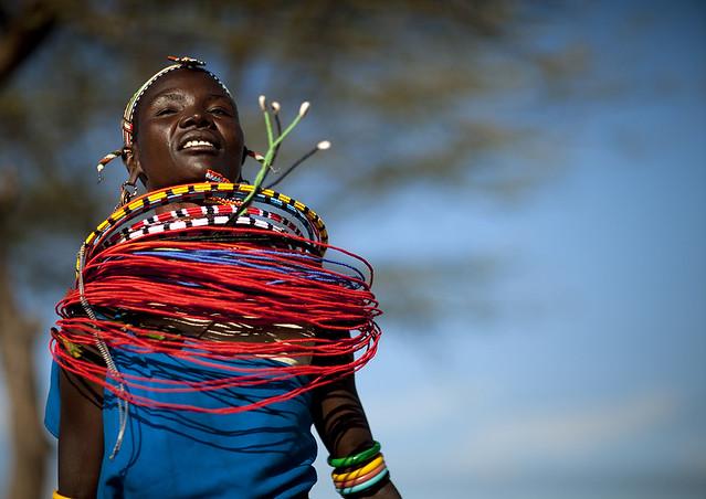 Samburu tribe woman with beaded necklaces dancing, Samburu County, Maralal, Kenya