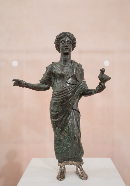 Bronze statuette of a maiden holding a dove as an offering to Juno, from Norba