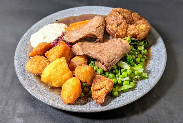 Slow Cooked Sirloin of Aberdeen Angus Beef, Red Wine Gravy Served with a Yorkshire Pudding, Pickled Red Cabbage, Jack & Scott Roasted Potatoes & Orange and Honey Glazed Carrots