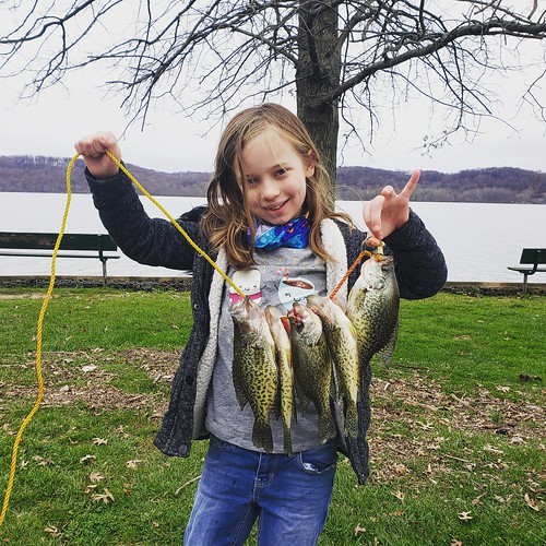 Photo of girl holding string of crappie