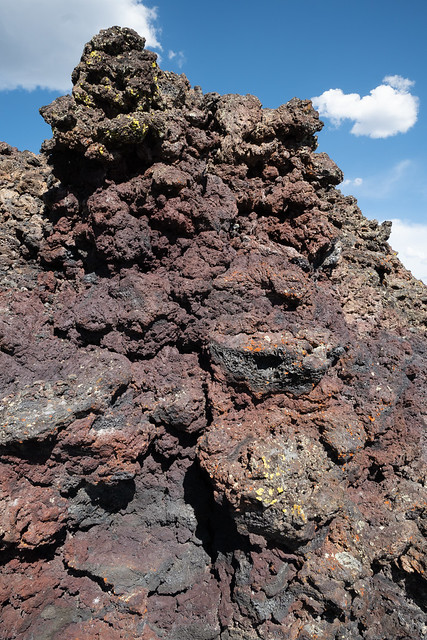 Colorful rock formation in volcanic rock at Craters of the Moon National Monument along Spatter Cones trail