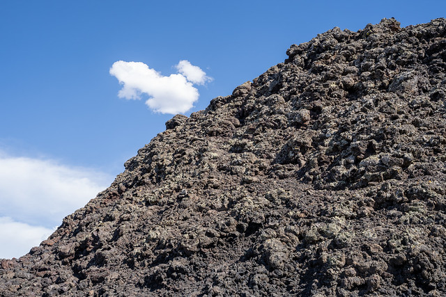 Craters of the Moon National Monument - black lava rock against blue sky