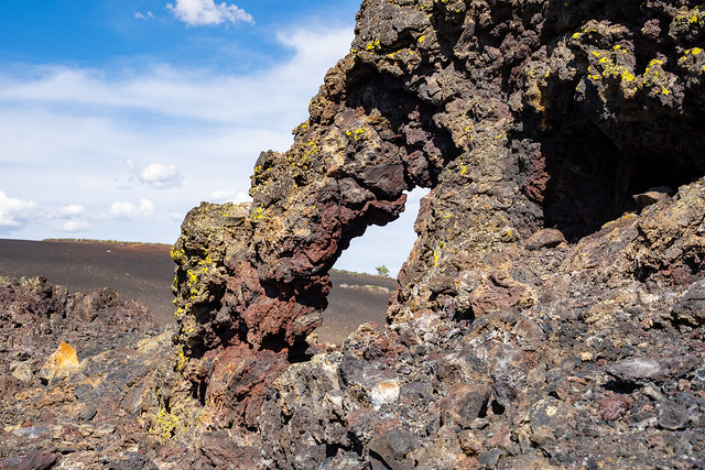 Colorful arch formation in volcanic rock at Craters of the Moon National Monument along Spatter Cones trail