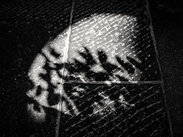 Shadow play on hard ground - city of Bern