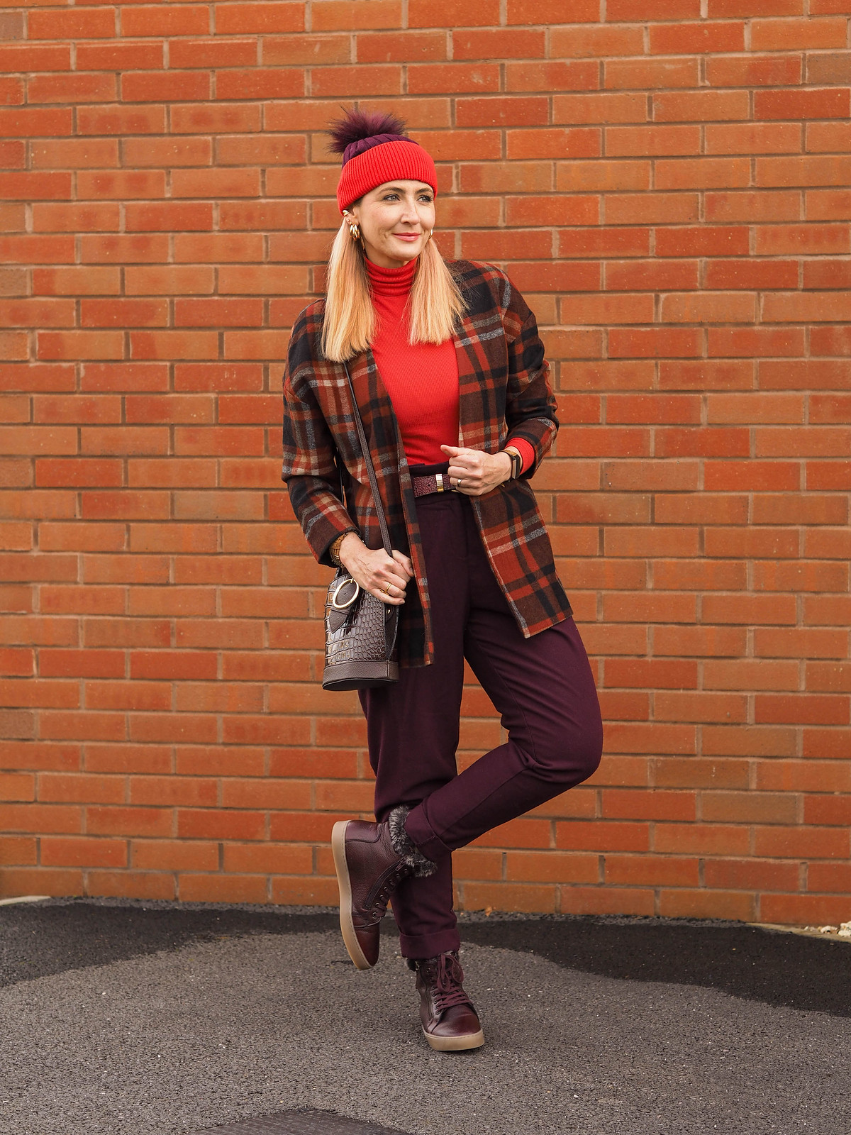 Styling a Timeless Tartan Jacket (an Autumn/Winter outfit of loose, red tartan jacket, plum peg leg trousers, tomato red roll neck, two-tone plum/red bobble hat & burgundy high-top trainers with faux-fur trim | Not Dressed As Lamb, Over 40 Fashion