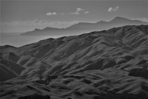 <p>Kapiti Island beyond the hillsides of Porirua.</p>