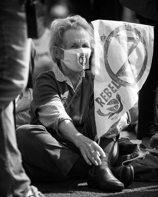 Portrait of elderly woman blocking a road