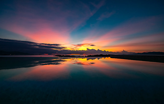 Infinity pool, islands beyond and a spectacular sunset!