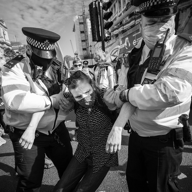 Police carry off an arrested woman