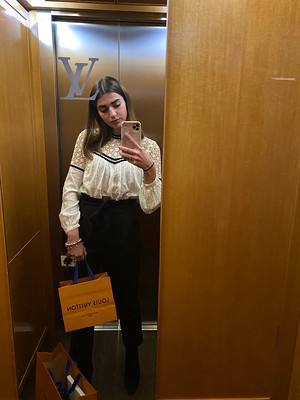 Erasmus+ participant taking a selfie in front of mirror in Louis Vuitton headquarters