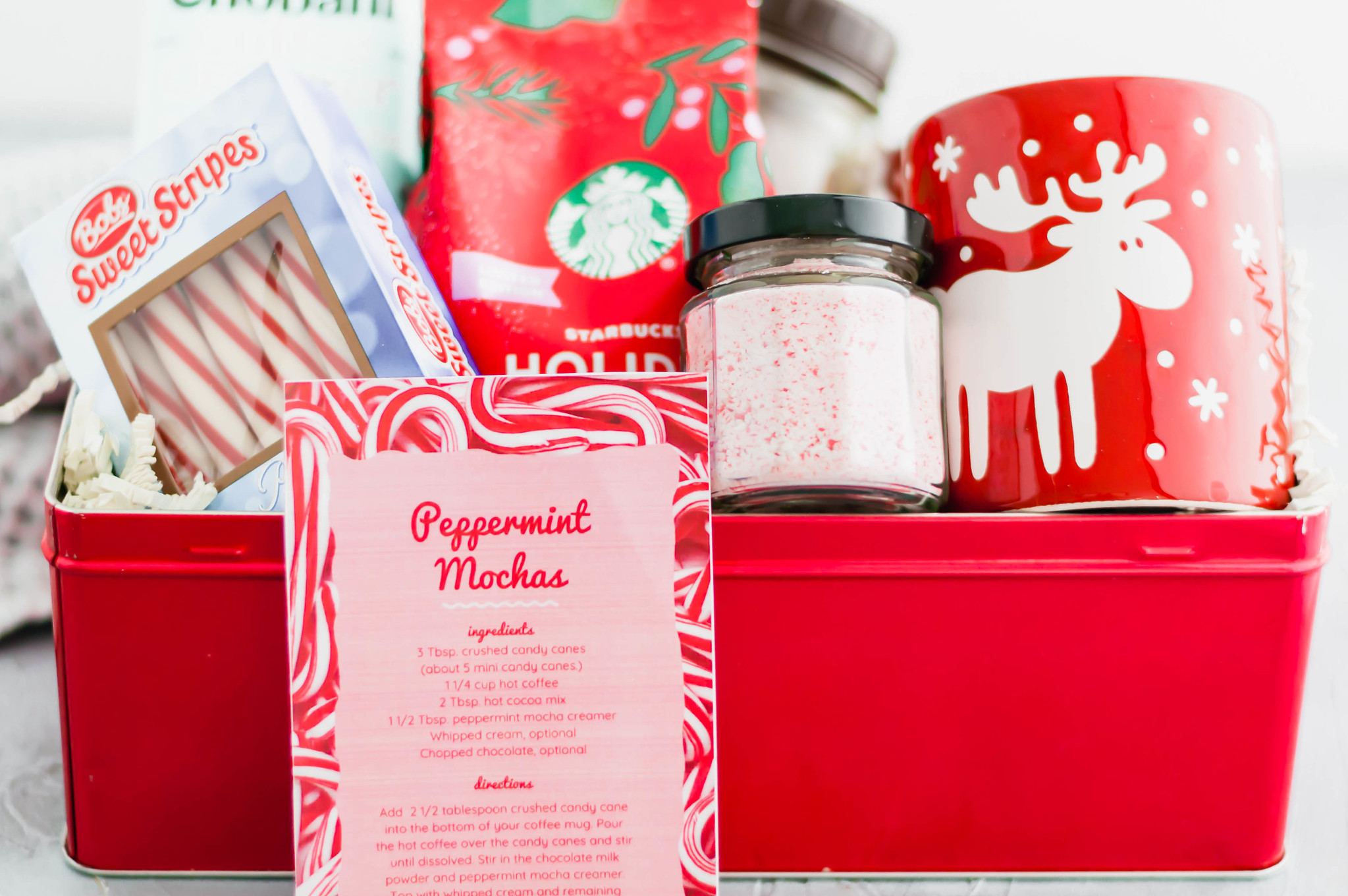 Looking for a fun, festive gift for a coffee lover in your life?! This Peppermint Mocha Kit is simple to put together and totally unique. All the ingredients required to make my delicious peppermint mochas in a fun tin or basket. Include the free printable recipe card so the recipient knows just how to make their delicious peppermint mocha at home.