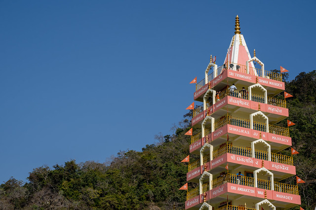 Rishikesh, India - Feburay 22, 2020: Tera Manzil Temple along the banks of the Ganges river in the foothills of the Himalayas