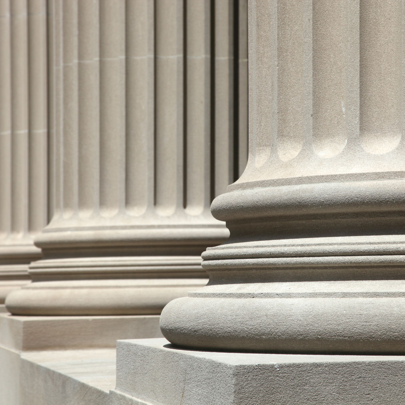 Close up photo of neoclassical columns in a row