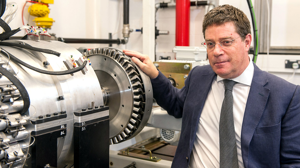 Professor Gary Lock with a gas turbine