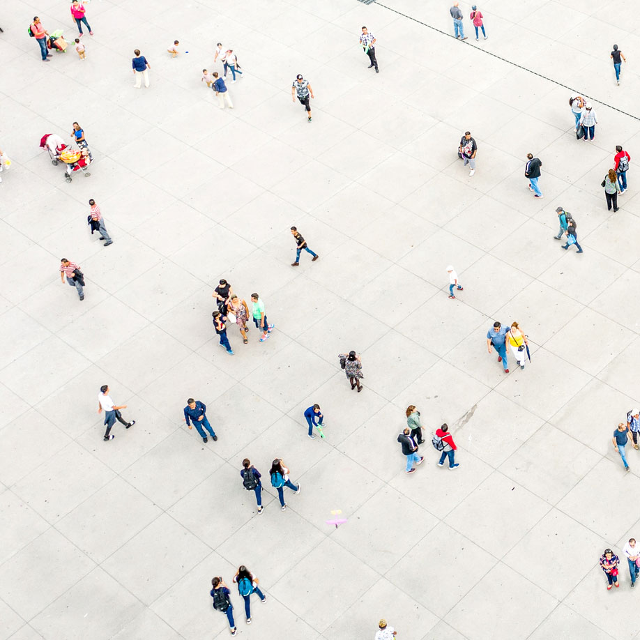 An aerial photo of a group of people walking down below