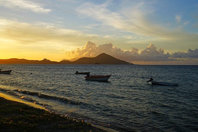 St Kitts & fishermen's boats at sunset, Newcastle Bay, Nevis