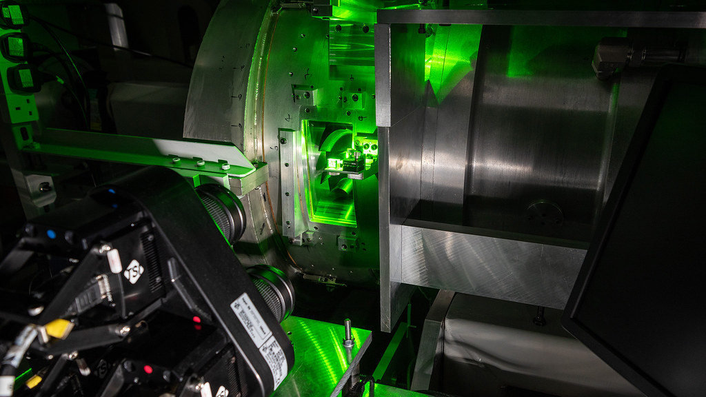 A green laser light illuminates a gas turbine rota disc