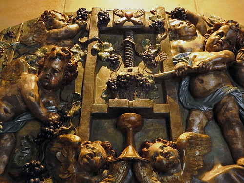 Bas-relief decoration of cherubs crushing grapes in a press in the Mission Hill Winery Museum