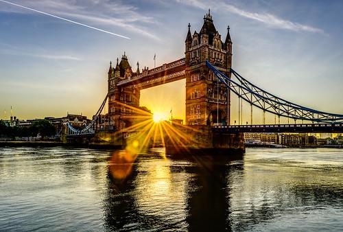 tower bridge london thames river sunrise sun rays flare burst aeroplane trail vapour