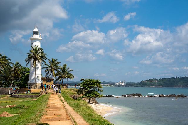 Galle, Sri Lanka - November 21, 2019: Tourists visit the Galle Fort Lighthouse in Sri Lanka along the Indian Ocean