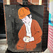 Boy holding falafel (street art)