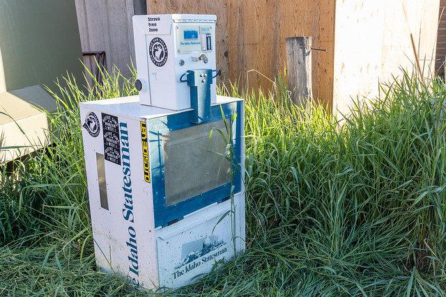 Stanley, Idaho - July 1, 2019: Vending machine for the Idaho Statesman newspaper is abandoned and empty, showing how periodicals are outdated due to advancing internet technology