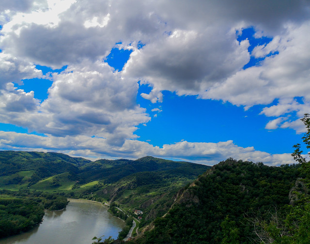 The clouds above the riverine mountains.