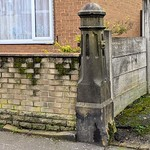 Lone stone pillar with benchmark in Preston