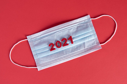 Medical face mask with 2021 text on red background | by wuestenigel