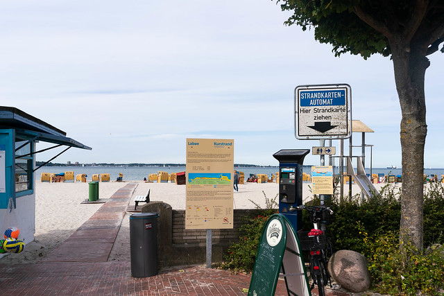 Paid beach entrance with a parking meter style ticket machine at the entrance