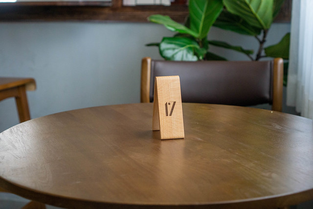 Wooden Table Number to Receive an Order on a Wooden Round Table in a Cafe