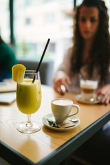 Fresh fruit juice and espresso coffee in cafe.