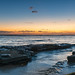 Rocky coastline sunrise seascape