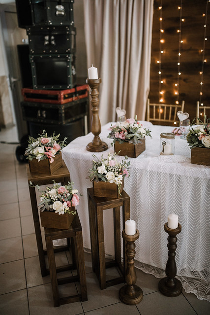 Candles on the candle holders near the decorated table.