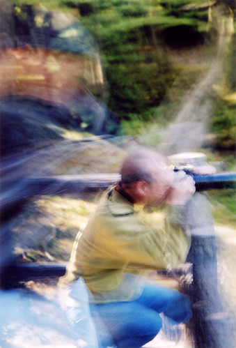 2003: eighty-year-old Japanese men with the latest digital technology, trying to get a shot of a brilliant turquoise kingfisher in the Kyoto Botanical Garden in Japan