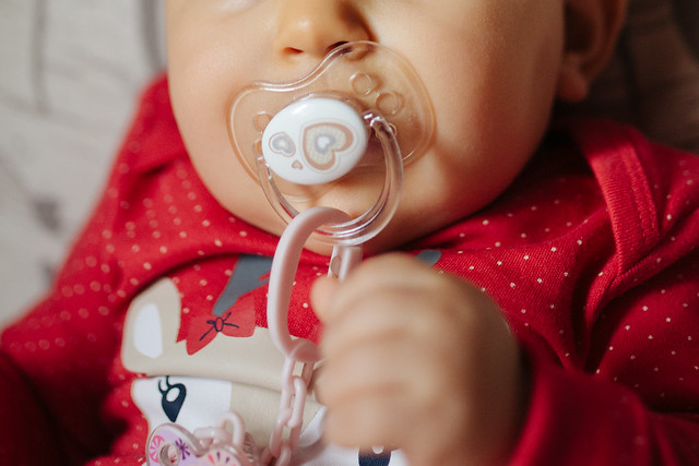 Close-up of a baby with a pacifier.
