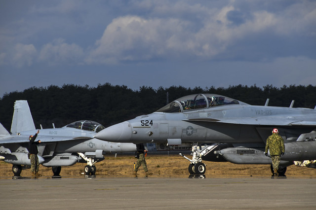 """MISAWA, Japan (Nov. 30, 2020) EA-18G Growlers, assigned to the """"Black Ravens"""" of Electronic Attack Squadron (VAQ) 135, taxi off the flight line at Misawa Air Base. VAQ-135 provides fully operational EA-18G aircraft to perform unrestricted Electronic Attack as needed throughout the world. (U.S. Navy photo by Mass Communication Specialist 2nd Class Jan David De Luna Mercado)"""