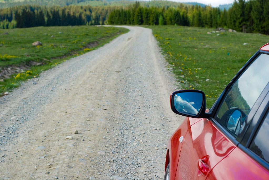 Red Car on a Mountain Path