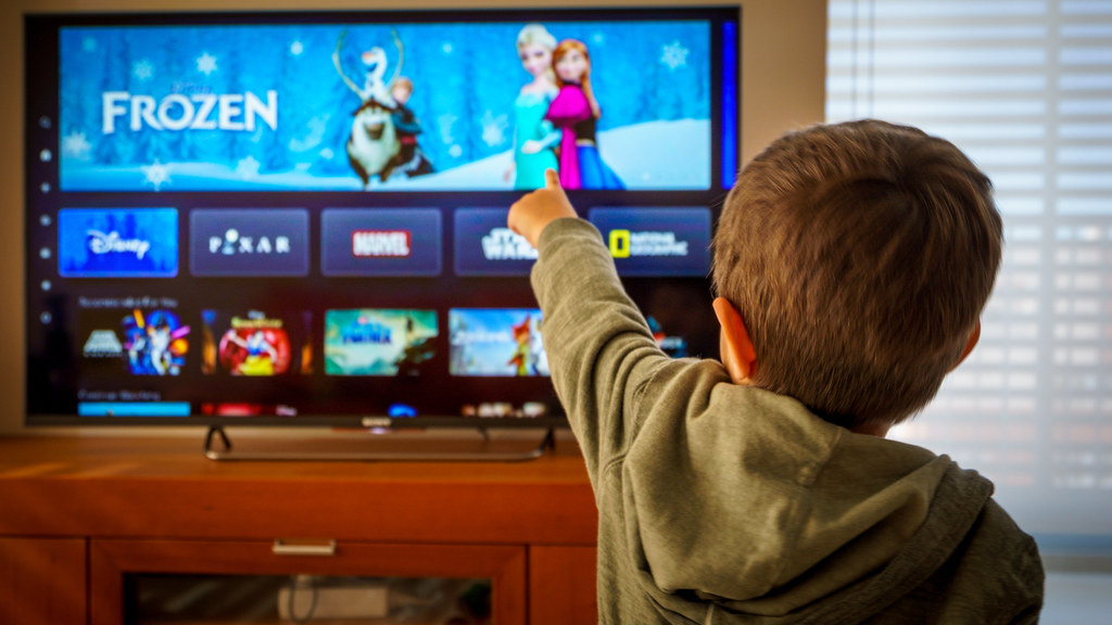Child watching TV (credit: AdobeStock).