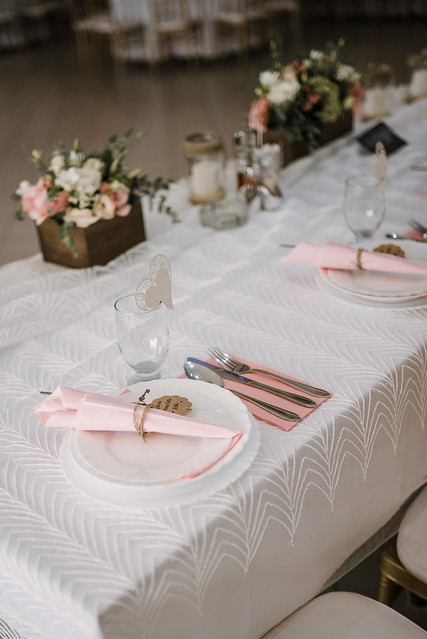 Utensils, napkins and flowers on a decorated table.