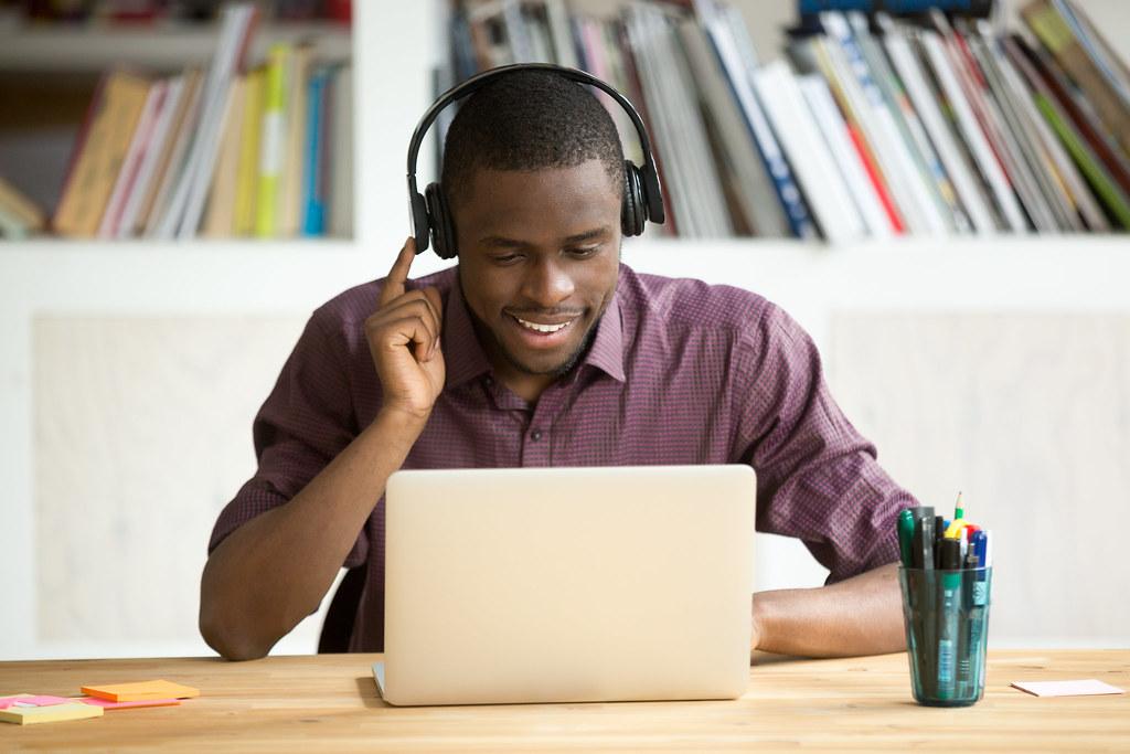 Man at laptop smiling