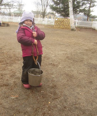 lifting the bucket with her lifting tool