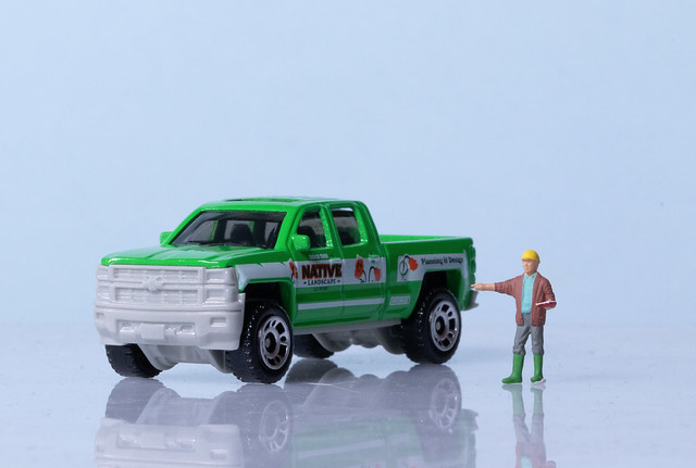 Miniature double cab truck and a man with hard hat