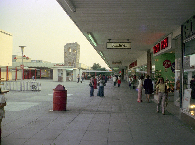 Late summer afternoon at the open-air Connecticut Post Shopping Center. It had an Alexander's department store, Child World, Cutlers records, Hill's and Shop & Shop supermarkets, HB Davis catalog showroom, an S.S. Kresge and more.  Milford, CT. Aug 1974