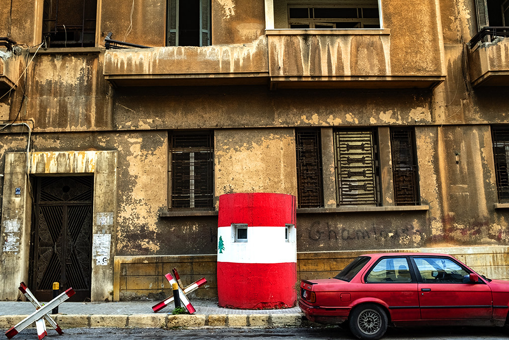 Old car and concrete sentry box in front of decaying house on 12-2-20--Beirut