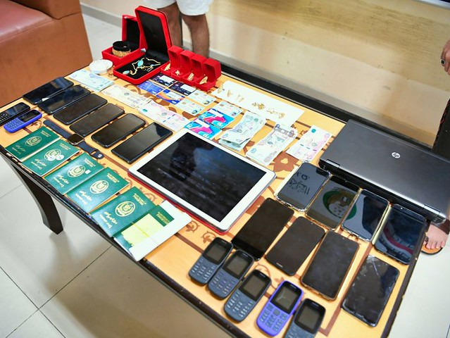 5836 A gang with SR 2.8 million phone fraud arrested in Ajman